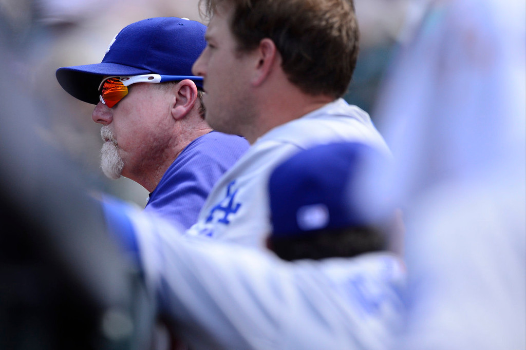 Description of . Los Angeles Dodgers hitting coach Mark McGwire takes in the action against the Colorado Rockies during the action in Denver on Monday, September 2, 2013. The Colorado Rockies hosted the Los Angeles Dodgers at Coors Field.   (Photo by AAron Ontiveroz/The Denver Post)