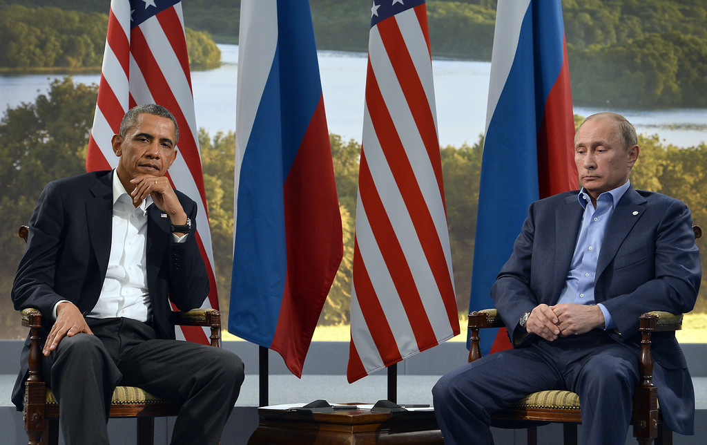 Description of . US President Barack Obama (L) holds a bilateral meeting with Russian President Vladimir Putin during the G8 summit at the Lough Erne resort near Enniskillen in Northern Ireland, on June 17, 2013. The conflict in Syria was set to dominate the G8 summit starting in Northern Ireland on Monday, with Western leaders upping pressure on Russia to back away from its support for President Bashar al-Assad. JEWEL SAMAD/AFP/Getty Images