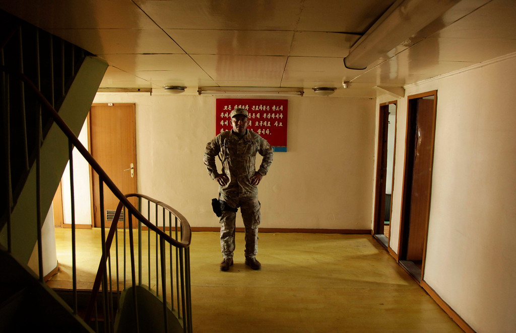Description of . A Panamanian police stands guard in an empty corridor aboard a North Korean-flagged ship at the Manzanillo International container terminal on the coast of Colon City, Panama, Tuesday, July 16, 2013.  (AP Photo/Arnulfo Franco)