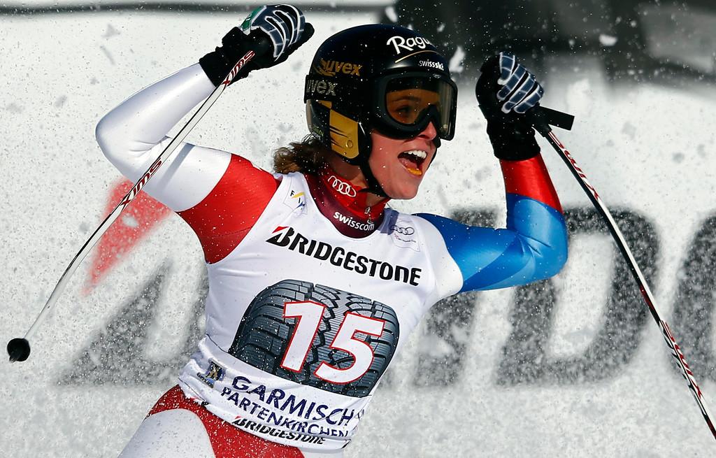 Description of . Lara Gut from Switzerland celebrates after the women's Alpine Skiing World Cup Downhill race in Garmisch-Partenkirchen March 2, 2013.  REUTERS/Michael Dalder