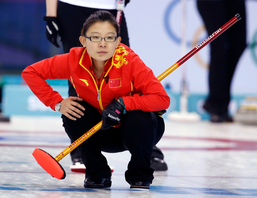 Description of . China's skip Wang Bingyu watches her throw during women's curling competition against Switzerland at the 2014 Winter Olympics, Monday, Feb. 17, 2014, in Sochi, Russia. (AP Photo/Robert F. Bukaty)