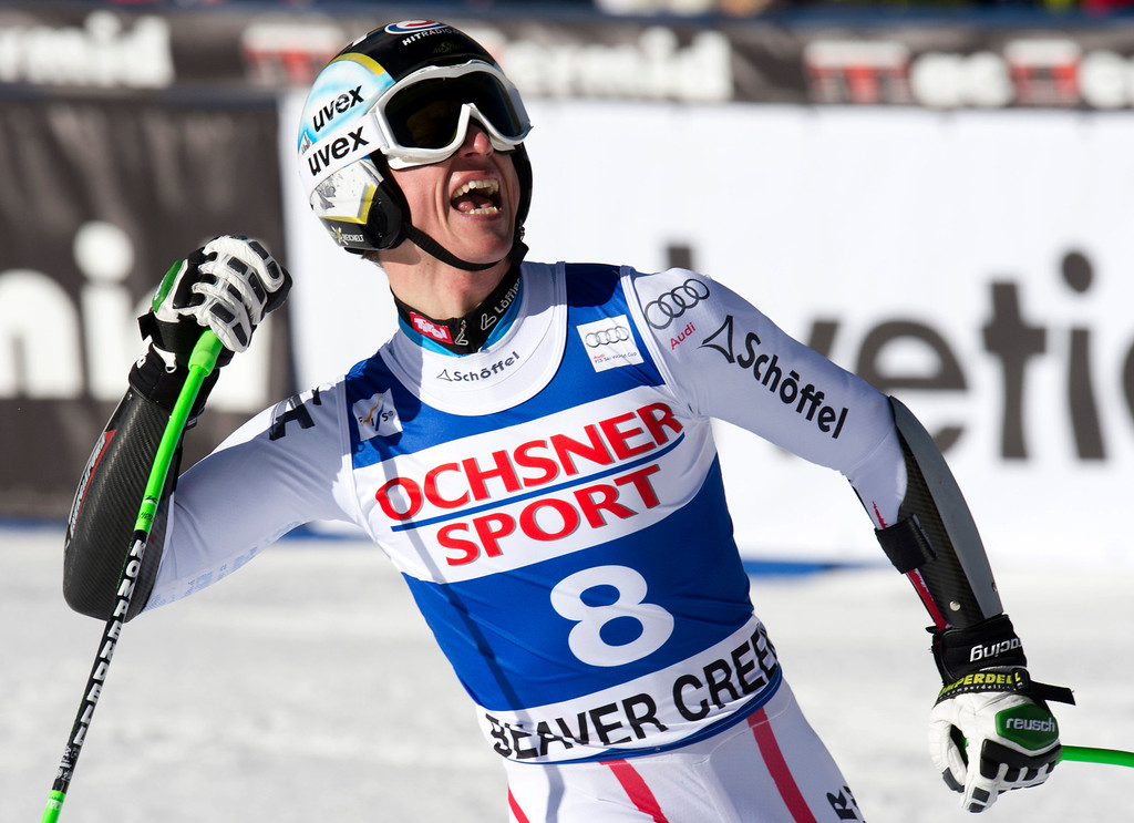 Description of . Hannes Reichelt of Austria celebrates finishing third in the FIS Alpine World Cup men\'s Super G on December 1, 2012 in Beaver Creek, Colorado.    A  DON EMMERT/AFP/Getty Images