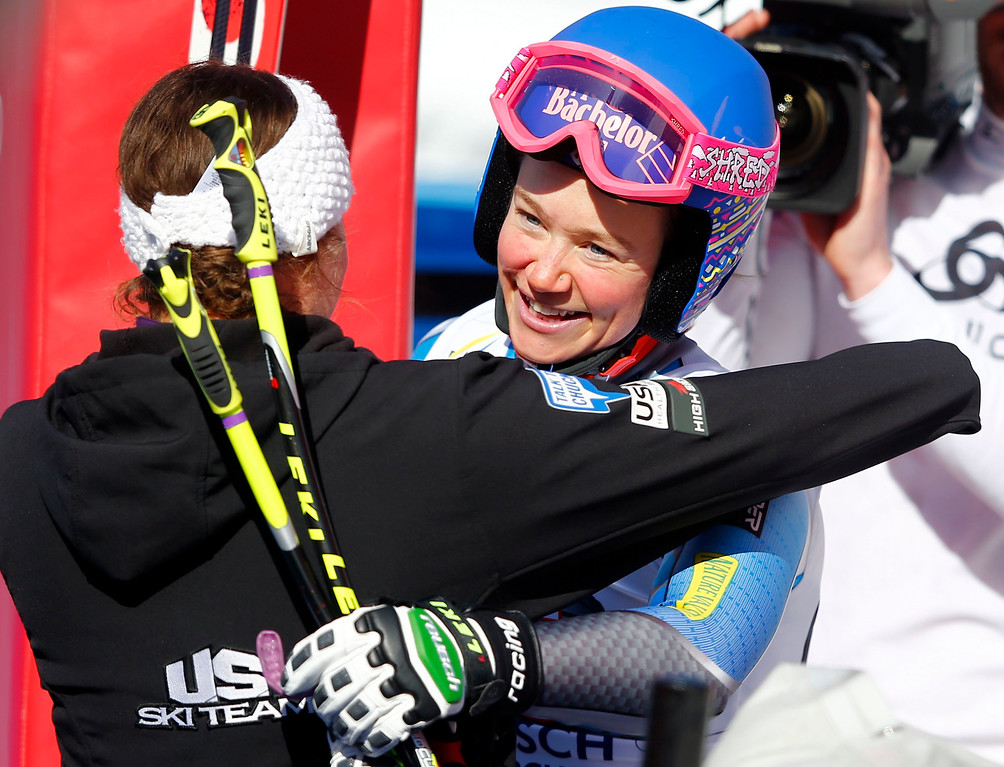 Description of . Laurenne Ross of the U.S. (R) celebrates after the women\'s Alpine Skiing World Cup Downhill race in Garmisch-Partenkirchen March 2, 2013.  REUTERS/Michael Dalder