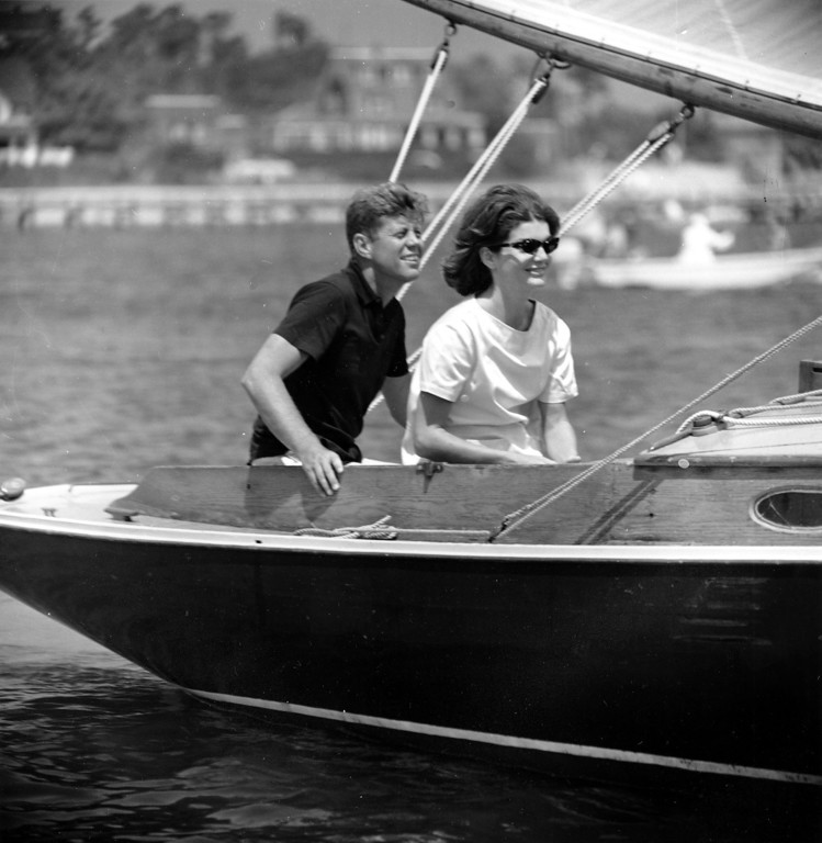 Description of . Sen.  Kennedy and Jacqueline relax aboard the family yacht, Marlin, before sailing around Nantucket sound at Hyannis Port, Mass., on July 19, 1960.