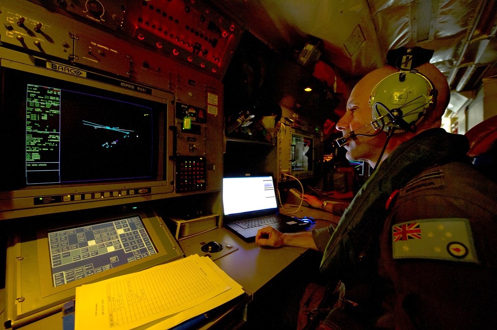 Description of . This handout photo taken on March 19, 2014 shows Royal Australian Air Force Sensor Employment Manager, Flight Lieutenant Smokey Dawson from 10 Squadron, keeping a watchful eye over the flow of information aboard an AP-3C Orion over the southern Indian Ocean.  Two objects possibly related to the search for missing Malaysia Airlines flight MH370 have been sighted in the southern Indian Ocean, Australian Prime Minister Tony Abbott said in a potential breakthrough on March 20.       AFP PHOTO / AUSTRALIAN DEFENCE/ SGT HAMISH PATERSON/AFP/Getty Images