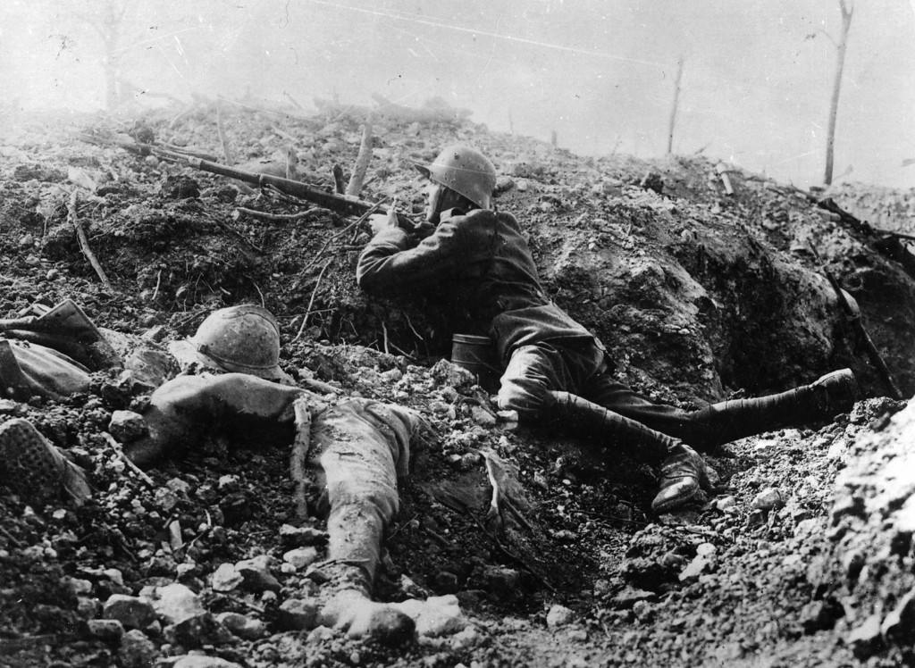 Description of . A German rifleman beside the corpse of a French soldier in a trench at Fort Vaux, France.   (Photo by Hulton Archive/Getty Images)