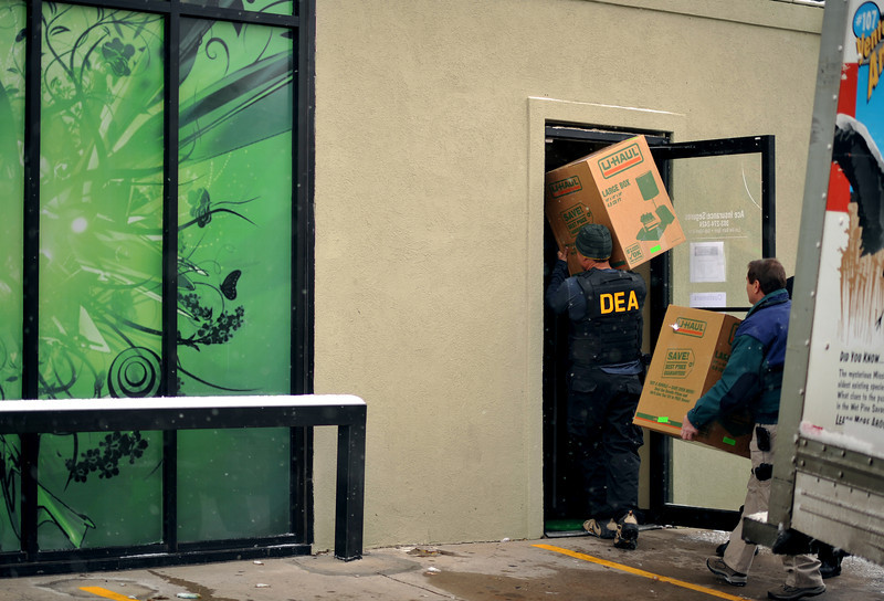 Officers are investigating VIP Cannabis at 2949 West Alameda Avenue in Denver, Colorado November 21, 2013. Federal authorities were executing search warrants and seizure warrants at multiple Denver-area medical marijuana facilities, according to the U.S. Department of Justice. (Photo by Hyoung Chang/The Denver Post)