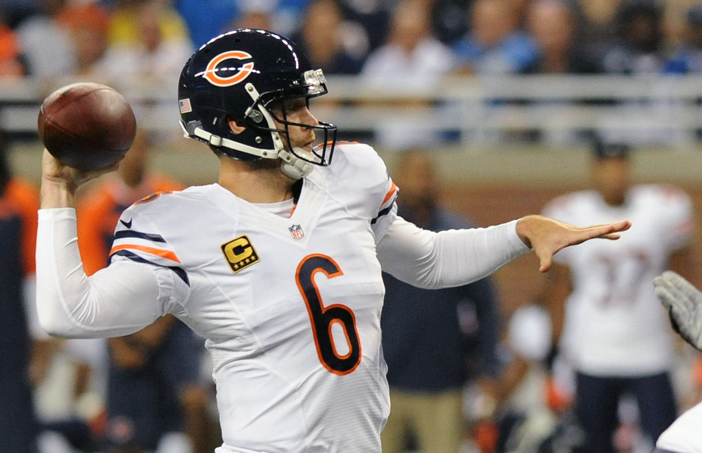 Description of . Chicago Bears quarterback Jay Cutler (6) throws during the first quarter of an NFL football game against the Detroit Lions at Ford Field in Detroit, Sunday, Sept. 29, 2013. (AP Photo/Jose Juarez)