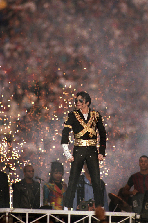 Description of . Michael Jackson performs during the Halftime show as the Dallas Cowboys take on the Buffalo Bills in Super Bowl XXVII at Rose Bowl on January 31, 1993 in Pasadena, California. The Cowboys won 52-17. (Photo by George Rose/Getty Images)