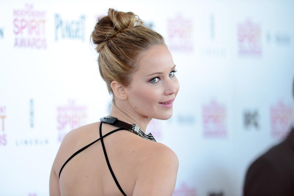 Description of . SANTA MONICA, CA - FEBRUARY 23:  Actress Jennifer Lawrence attends the 2013 Film Independent Spirit Awards at Santa Monica Beach on February 23, 2013 in Santa Monica, California.  (Photo by Jason Merritt/Getty Images)