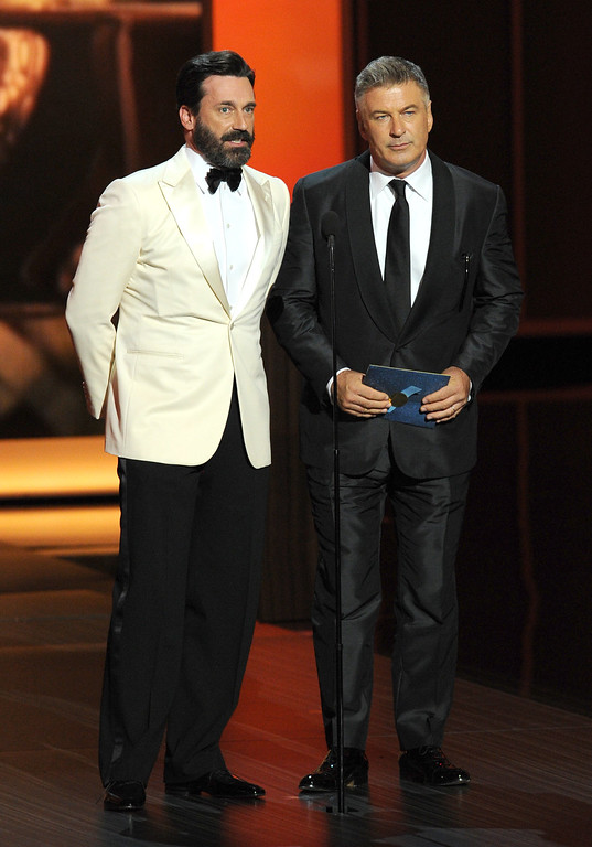Description of . Actors Jon Hamm and Alec Baldwin speak onstage during the 65th Annual Primetime Emmy Awards held at Nokia Theatre L.A. Live on September 22, 2013 in Los Angeles, California.  (Photo by Kevin Winter/Getty Images)