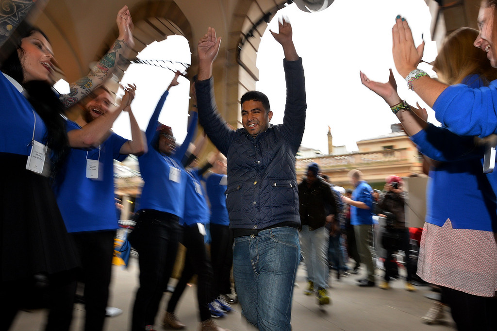 Description of . Customers are cheered on by Apple staff as they enter the Apple store ahead of the iPhone 5S and 5C going on sale in central London on September 20, 2013.   Apple\'s eagerly-awaited iPhone 5S and 5C went of sale in London at 8am. AFP PHOTO / BEN STANSALL/AFP/Getty Images