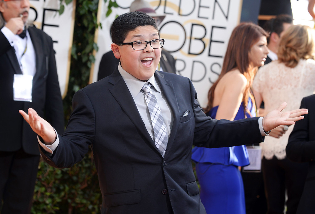Description of . Rico Rodriguez arrives at the 71st annual Golden Globe Awards at the Beverly Hilton Hotel on Sunday, Jan. 12, 2014, in Beverly Hills, Calif. (Photo by Jordan Strauss/Invision/AP)