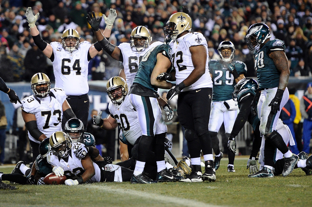 Description of . PHILADELPHIA, PA - JANUARY 04:  Mark Ingram #22 of the New Orleans Saints runs for a 4 yard touchdown in the third quarter against the Philadelphia Eagles during their NFC Wild Card Playoff game at Lincoln Financial Field on January 4, 2014 in Philadelphia, Pennsylvania.  (Photo by Maddie Meyer/Getty Images)