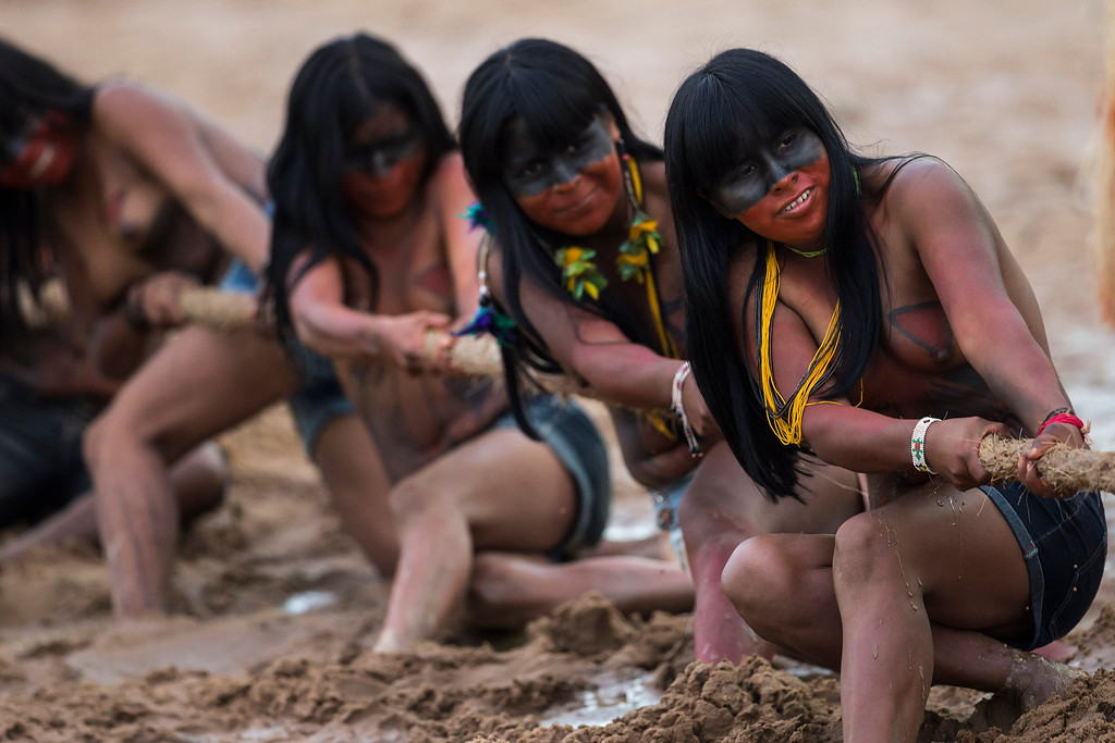 Description of . EDS NOTE NUDITY - Mamainde Indian women participate in a tug of war competition during the indigenous games in Cuiaba, Brazil, Tuesday, Nov. 12, 2013. Around 1,600 Indians from 48 tribes are celebrating Brazil's indigenous cultures during the 12th edition of the Games of the Indigenous People, which runs until Nov. 16. (AP Photo/Felipe Dana)