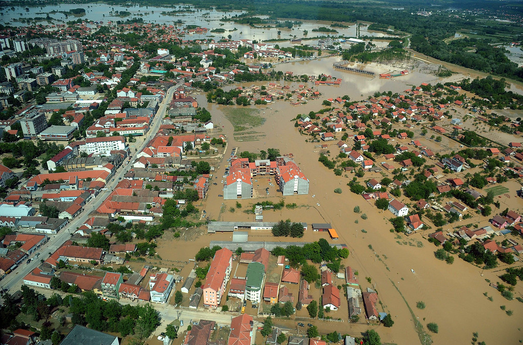 Description of . Aerial view shows the flooded town of Obrenovac, 40 kilometers west of Belgrade, on May 19, 2014. The Balkans braced for more misery as the death toll from the worst floods in a century rose to 47 and rising waters forced thousands more to flee their homes. Muddy waters from the Sava River have submerged houses, churches, mosques and roads in Bosnia, Serbia and Croatia after record rainfall wreaked havoc across the central European region.  AFP PHOTO / ALEXA STANKOVIC/AFP/Getty Images