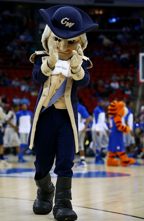 Description of . George Washington Colonials mascot, George, performs in the first half against the Memphis Tigers during the Second Round of the 2014 NCAA Basketball Tournament at PNC Arena on March 21, 2014 in Raleigh, North Carolina.  (Photo by Streeter Lecka/Getty Images)