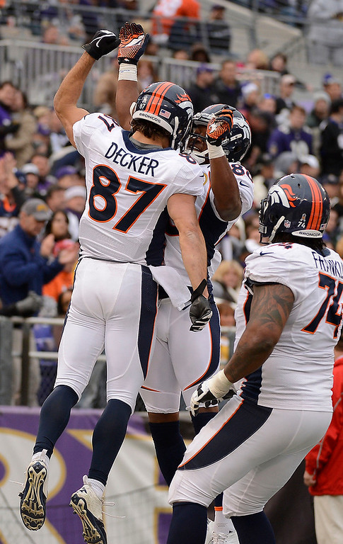 Description of . Denver Broncos wide receiver Eric Decker (87) celebrates his 51-yard touchdown catch with Denver Broncos wide receiver Demaryius Thomas (88) during the third quarter Sunday, December 16, 2012 at M&T Bank Stadium.  John Leyba, The Denver Post
