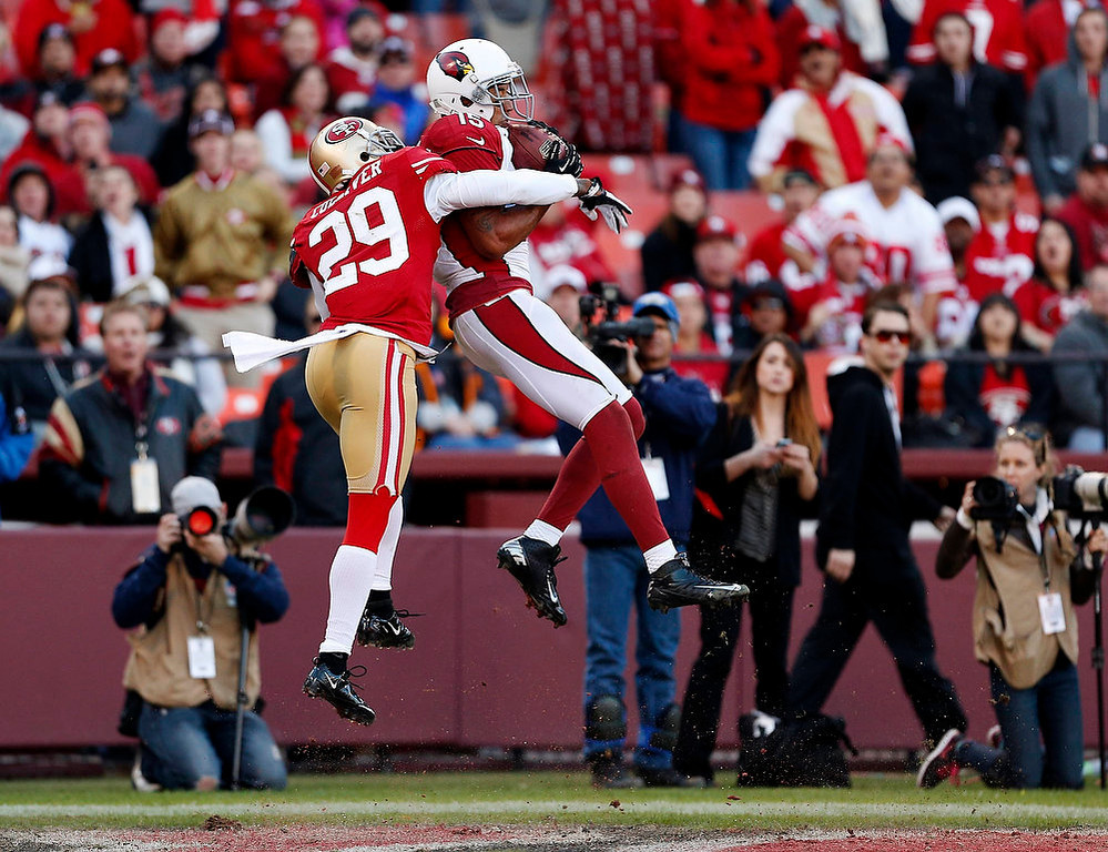 Description of . Arizona Cardinals wide receiver Michael Floyd (R) makes a leaping catch to score a touchdown ahead of San Francisco 49ers cornerback Chris Culliver (29) during the fourth quarter of their NFL football game in San Francisco, California December 30, 2012.   REUTERS/Beck Diefenbach   (UNITED STATES - Tags: SPORT FOOTBALL TPX IMAGES OF THE DAY)