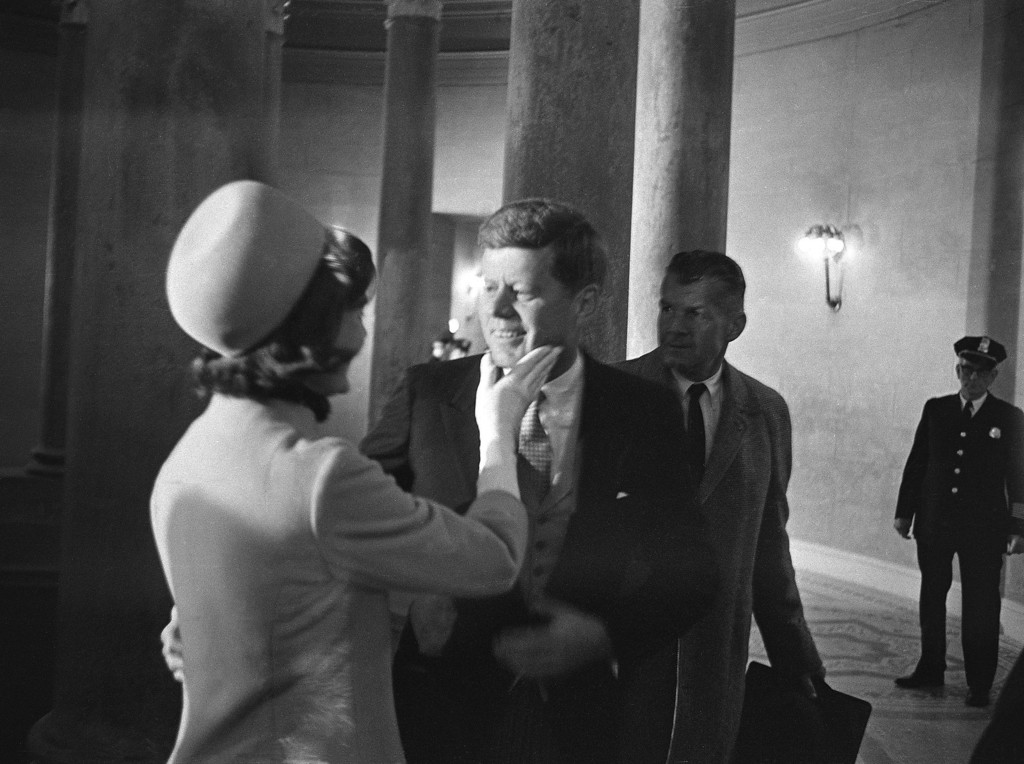 Description of . Jacqueline Kennedy gives a chuck under the chin to  her husband, moments after he left the inaugural stand to became the 35th president of the United States on January 20, 1961. Henry Burroughs, Associated Press file
