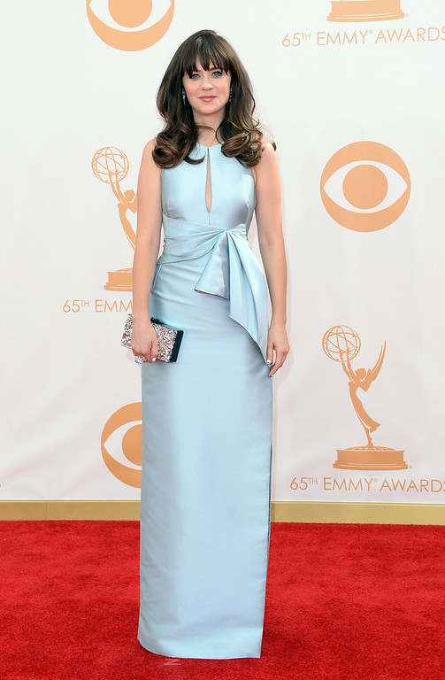 Description of . Actress Zooey Deschanel arrives at the 65th Annual Primetime Emmy Awards held at Nokia Theatre L.A. Live on September 22, 2013 in Los Angeles, California.  (Photo by Jason Merritt/Getty Images)