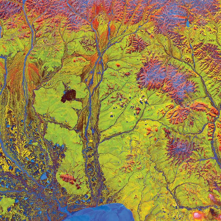 Description of . Ribbon Lakes, Russia The vivid blue half circle (bottom) in this Landsat 5 image from 2005 is Russia�s Chaunskaya Bay in northeastern Siberia. Two major rivers, the Chaun and Palyavaam, flow into the bay, which in turn opens into the Arctic Ocean. Ribbon lakes and bogs are present throughout the area, created by depressions left by receding glaciers. Owing to its extreme northern location, the bay is covered by ice most of the year.   NASA