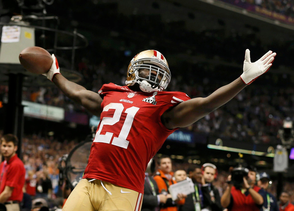 Description of . San Francisco 49ers running back Frank Gore (21) celebrates his third quarter touchdown against the Baltimore Ravens in the NFL Super Bowl XLVII football game in New Orleans, Louisiana, February 3, 2013. REUTERS/Lucy Nicholson
