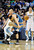 Denver Nuggets guard Wilson Chandler, left, steals the ball from Minnesota Timberwolves center Greg Stiemsma, right, in the second half of an NBA basketball game on Saturday, March 9, 2013, in Denver. (AP Photo/Chris Schneider)