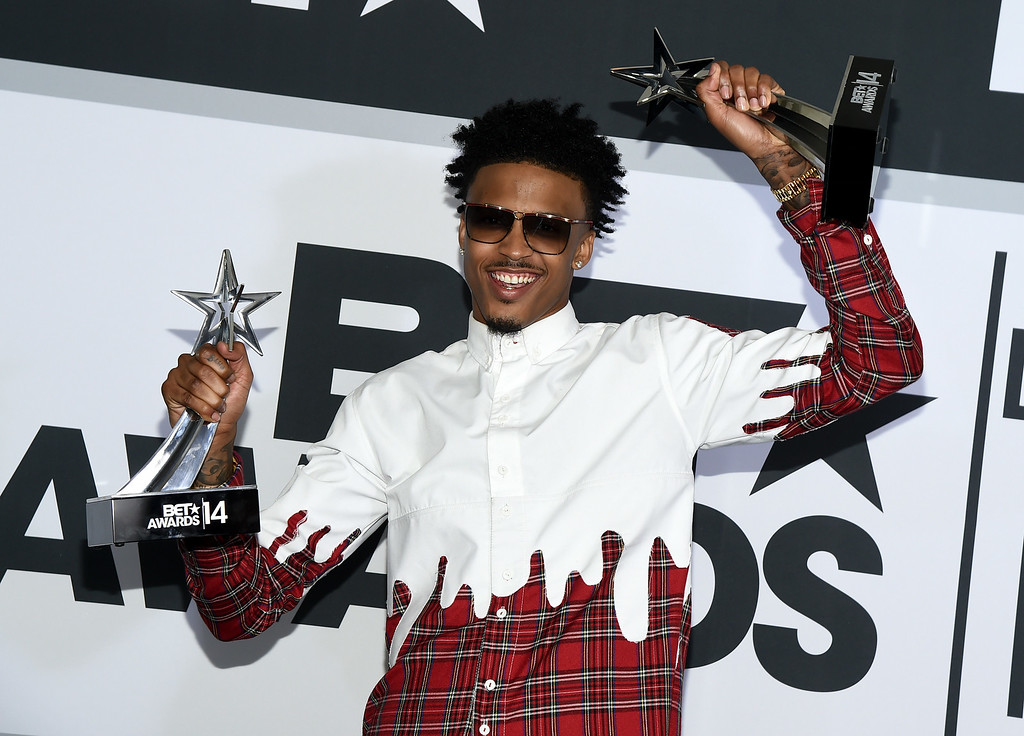 Description of . Singer August Alsina poses in the press room during the BET AWARDS '14 at Nokia Theatre L.A. LIVE on June 29, 2014 in Los Angeles, California.  (Photo by Michael Buckner/Getty Images for BET)