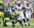 Green Bay Packers wide receiver Randall Cobb (L) is tackled by Minnesota Vikings linebacker Jasper Brinkley during the first half of a NFL football game in Green Bay, Wisconsin December 2, 2012. REUTERS/Darren Hauck