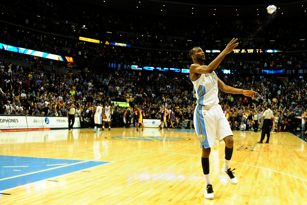 Description of . Denver Nuggets small forward Corey Brewer (13) throws his headband into the stands following the Nuggets' 126-114 win over the Los Angeles Lakers at the Pepsi Center on Wednesday, December 26, 2012. AAron Ontiveroz, The Denver Post