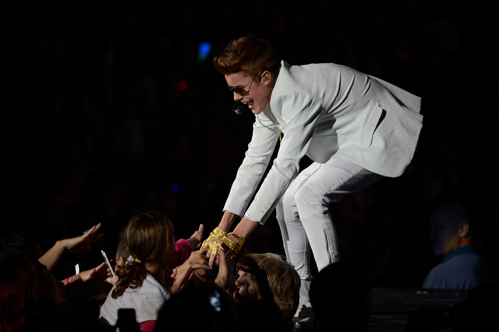 Description of . Justin  Bieber performs to a sold out crowd at Pepsi Center during his  \'Believe\' Tour stop in Denver. John Leyba, The Denver Post