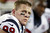 Houston Texans defensive end J.J. Watt looks up from the bench during the third quarter of an NFL football game against the New England Patriots in Foxborough, Mass., Monday, Dec. 10, 2012. (AP Photo/Steven Senne)