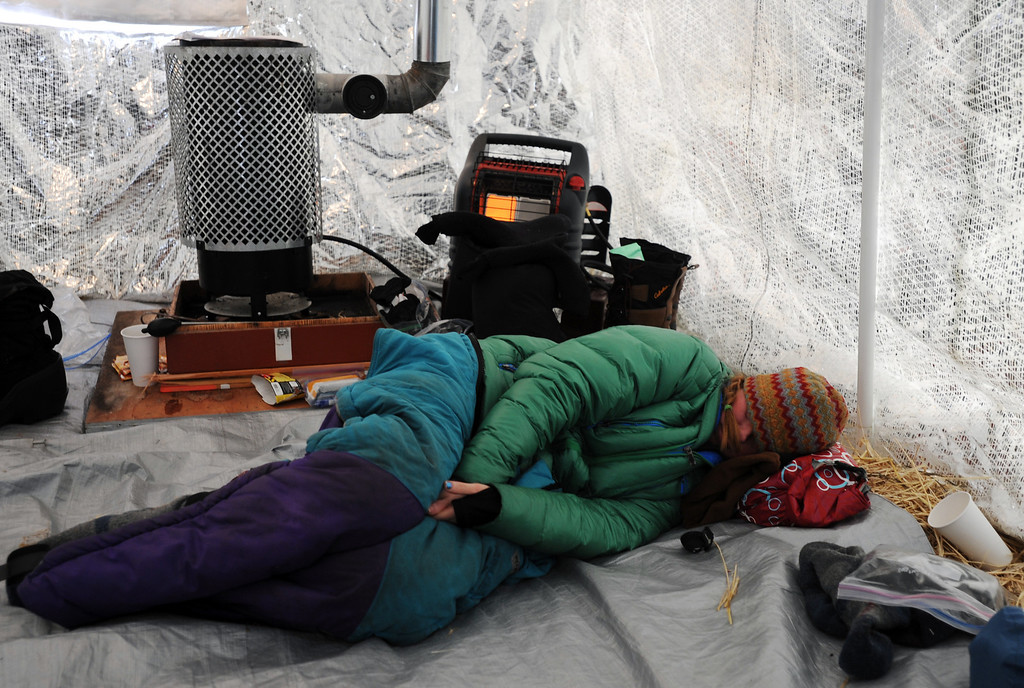 Description of . Angie Taggart rests in a musher tent at the Finger Lake checkpoint in Alaska during the Iditarod Trail Sled Dog Race on Monday, March 4, 2013. (AP Photo/The Anchorage Daily News, Bill Roth)