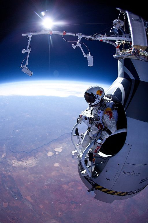 Description of . In this photo provided by Red Bull, Pilot Felix Baumgartner of Austria is seen before his jump during the first manned test flight for Red Bull Stratos on March 15, 2012 in Roswell, New Mexico. In this test he reach the altitude 21800 meters (71500 ft) and landed safely near Roswell. Red Bull Stratos is a mission to the edge of the earths atmosphere, where upon reaching altitude of 120,000 feet by helium balloon, pilot and base jumper Felix Baumgartner will then free fall to the ground in an attempt to break the speed of sound. (Photo by Jay Nemeth/Red Bull via Getty Images)