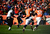 Denver Broncos wide receiver Trindon Holliday (11) runs back a punt for an 89-yard touchdown on the Broncos' first offensive play in the first quarter. The Denver Broncos vs Baltimore Ravens AFC Divisional playoff game at Sports Authority Field Saturday January 12, 2013. (Photo by AAron  Ontiveroz,/The Denver Post)