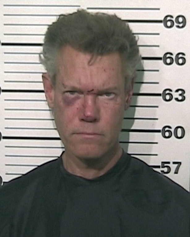 Description of . This Grayson County Sheriff's Office booking photo obtained August 8, 2012 shows US country singer Randy Travis. Randy Travis was arrested and charged with driving while intoxicated and retaliation and obstruction the late August 7, 2012, according to the Grayson County Sheriff's Office. The Dallas Morning News  confirmed with the sheriff's office that the singer had been held in the Grayson County Jail and has been released on bond. He was found naked by a witness who called 911 about a one-vehicle accident and a man lying in the street, near Tioga, Texas according to the sheriff's office.  AFP PHOTO / GRAYSON COUNTY SHERIFF'S OFFICE