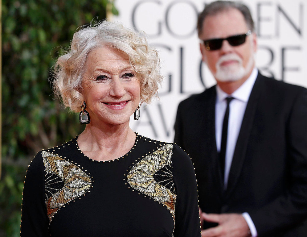 Description of . Actress Helen Mirren and director Taylor Hackford arrive at the 70th annual Golden Globe Awards in Beverly Hills, California, January 13, 2013.  REUTERS/Mario Anzuoni