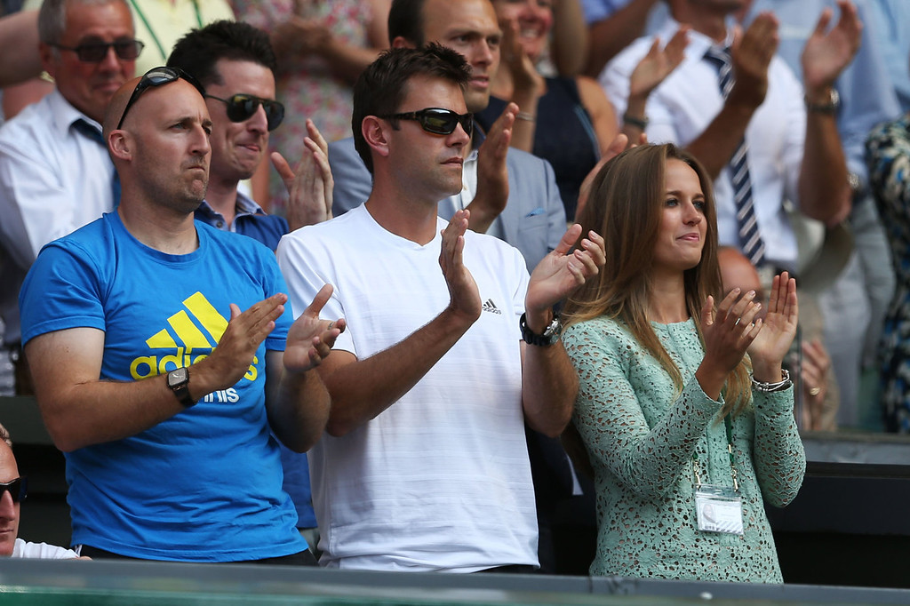 Description of . Kim Sears, the girlfriend of Andy Murray of Great Britain and Jez Green (L) applaud during his Gentlemen's Singles Final match against Novak Djokovic of Serbia on day thirteen of the Wimbledon Lawn Tennis Championships at the All England Lawn Tennis and Croquet Club on July 7, 2013 in London, England.  (Photo by Clive Brunskill/Getty Images)