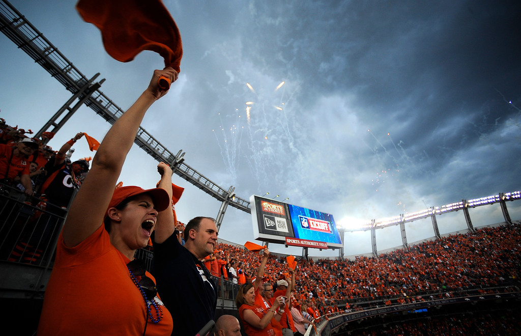 Description of . Broncos fans cheer as the Broncos take the field before the game.  (Photo by AAron Ontiveroz/The Denver Post)
