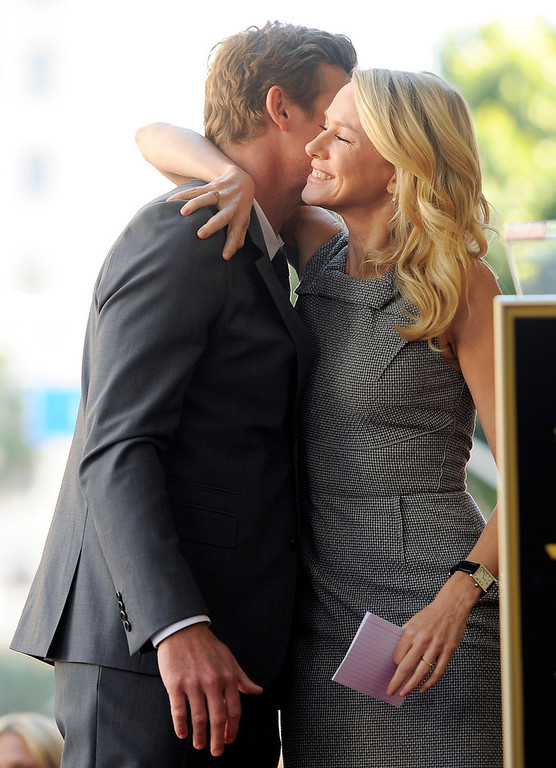 Description of . Actor Simon Baker gets a hug from actress Naomi Watts during a ceremony to award him a star on the Hollywood Walk of Fame, on Thursday, Feb. 14, 2013 in Los Angeles. Australian performers Baker and Watts worked together in the 2005 film
