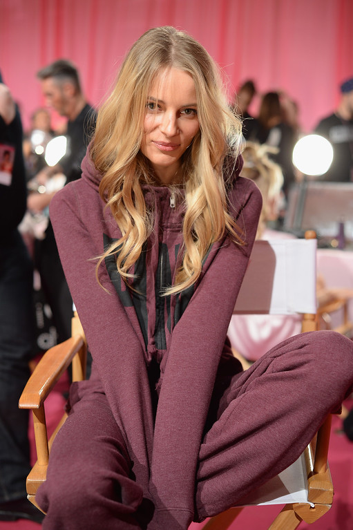 Description of . Model Ieva Laguna prepares at the 2013 Victoria's Secret Fashion Show hair and make-up room at Lexington Avenue Armory on November 13, 2013 in New York City.  (Photo by Dimitrios Kambouris/Getty Images for Victoria's Secret)