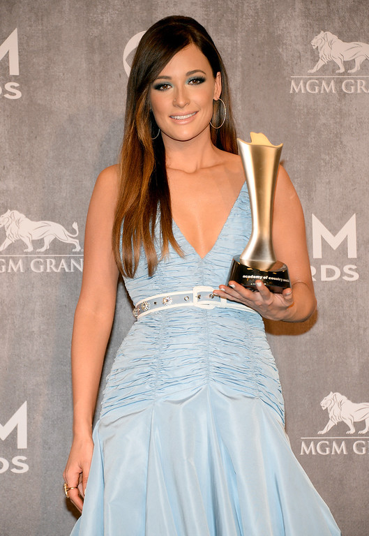 Description of . Kacey Musgraves poses in the press room with the award for album of the year at the 49th annual Academy of Country Music Awards at the MGM Grand Garden Arena on Sunday, April 6, 2014, in Las Vegas. (Photo by Al Powers/Powers Imagery/Invision/AP)