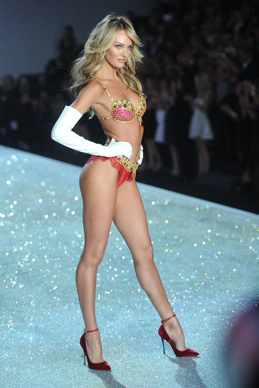 Description of . Model Candice Swanepoel walks the runway at the 2013 Victoria's Secret Fashion Show at Lexington Avenue Armory on November 13, 2013 in New York City.  (Photo by Jamie McCarthy/Getty Images)