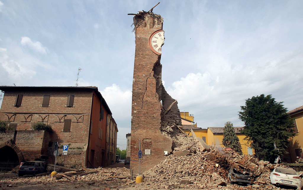 Description of . The old tower is seen collapsed after an earthquake in Finale Emilia May 20, 2012. A strong earthquake rocked a large swathe of northern Italy early on Sunday, killing at least three people and causing serious damage to the area's cultural heritage. The epicentre of the 6.0 magnitude quake, the strongest to hit Italy in three years, was in the plains near Modena in the Emilia-Romagna region of the Po River Valley. REUTERS/Giorgio Benvenuti