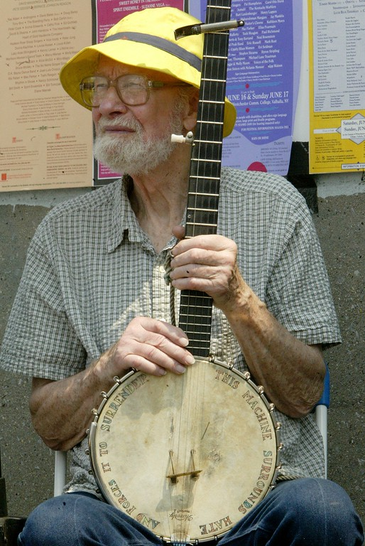 Description of . Musician Pete Seeger holds his banjo during a news conference celebrating the placement of the Hudson River sloop 'Clearwater' on the national register of historic places, Thursday, May 13, 2004, in New York. (AP Photo/Mary Altaffer)