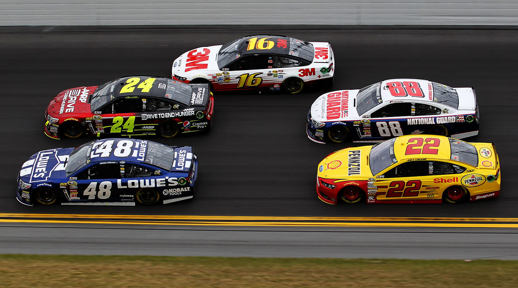 . Jimmie Johnson, driver of the #48 Lowe\'s Chevrolet, and Jeff Gordon, driver of the #24 Drive To End Hunger Chevrolet, lead the field during the NASCAR Sprint Cup Series Daytona 500 at Daytona International Speedway on February 24, 2013 in Daytona Beach, Florida.  (Photo by Todd Warshaw/Getty Images)