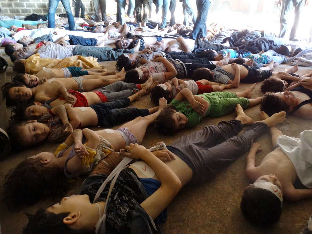Description of . A handout image released by the Syrian opposition's Shaam News Network shows bodies of children and adults laying on the ground as Syrian rebels claim they were killed in a toxic gas attack by pro-government forces in eastern Ghouta, on the outskirts of Damascus on August 21, 2013.  AFP PHOTO/HO/SHAAM NEWS NETWORK     /AFP/Getty Images
