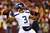 Russell Wilson #3 of the Seattle Seahawks looks to pass against the Washington Redskins during the NFC Wild Card Playoff Game at FedExField on January 6, 2013 in Landover, Maryland.  (Photo by Al Bello/Getty Images)