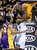 Denver Nuggets Kenneth Faried (R) slips past Los Angles Lakers Metta World Peace (L) for a shot during their NBA basketball game in Denver, Colorado February 25, 2013. REUTERS/Mark Leffingwell